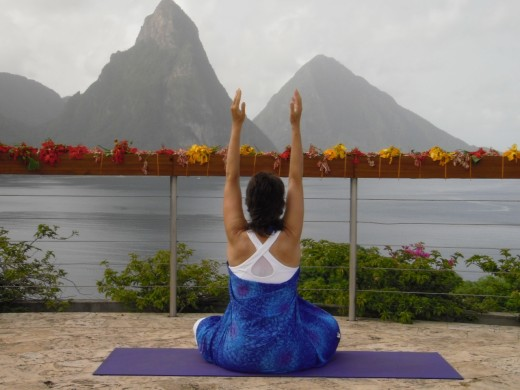 Seated Mountain Pose on the Celestial Terrace, decorated with flowers from last night's wedding party. Jade Mountain in Saint Lucia is an ideal resort for romantic getaways and on the beach holidays.