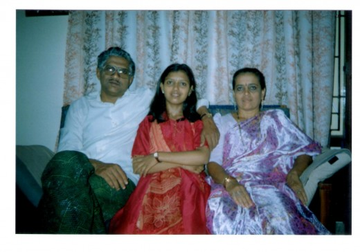 The little talent-with her parents, at her sweet home.