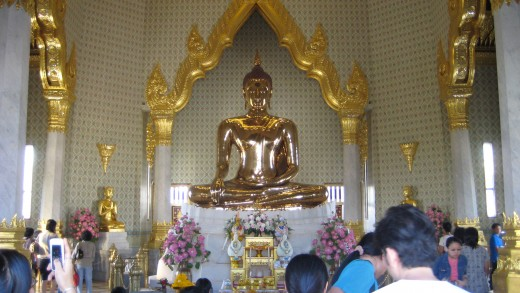 The Golden Buddha - The right hand pointing downwards signifies touching the earth during Buddha's enlightment