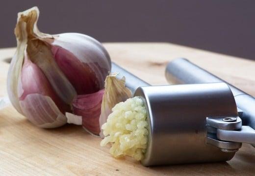 Garlic and a Garlic press