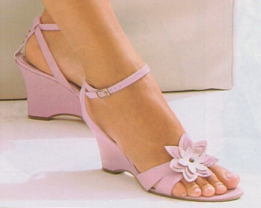 Pink sandals with matching nail polish