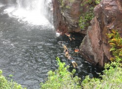 bathers under the falls