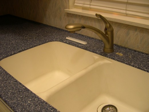 Home kitchen sinks often have garbage disposers installed to help get rid of kitchen waste.