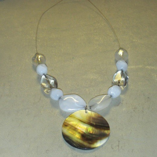 Now add one clear bead to each side of the necklace.