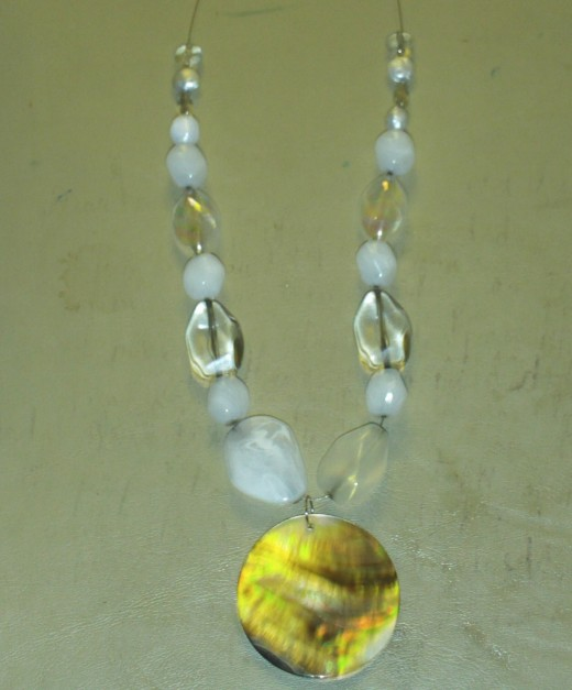 A small clear bead was added on each side of the necklace.