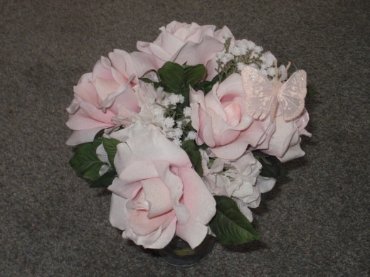 Try using artificial flowers for your wedding bouquet - they're beautiful, inexpensive, and they won't die