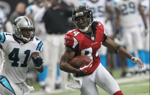 Atlanta Falcons wide receiver Roddy White (84) is chased by Carolina Panthers cornerback Captain Munnerlyn (41) during an NFL football game at the Georgia Dome in Atlanta Sunday, Jan. 2, 2011. (AP Photo/John Bazemore)