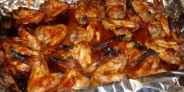 Chicken wings in pan lined with foil.  Foil keeps the wings from sticking to the pan and making a huge mess.