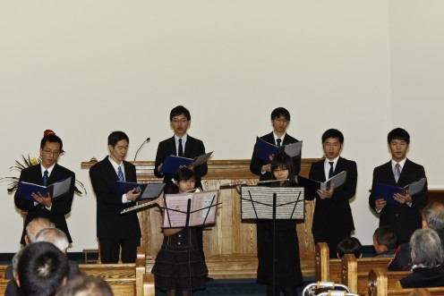 From left to right: William Chen, John Chang, Kevin Chen, Howard Chiam, Peter Chen, Andy Hsieh In front of the boys from left to right are: Nina Chiu, Jessica Hsieh (both are playing the flute)  Pianist, Monique Chiam, Conductor, Ann Hsieh.