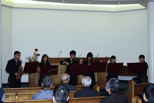 Ensemble: From left to right: Peter Chiu (Alto Saxophone), Lily Chiu (Clarinet), Andy Hsieh (Violin), Jessica Hsieh (Violin), Nina Chiu (Flute), Lee-Young Chen (Flute)  Pianist, Sylvia Hung, Conductor, Ann Hsieh.