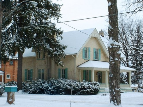 Winter scene with old house