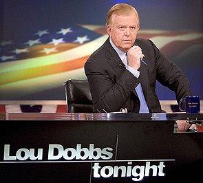 Lou Dobbs at the CNN desk.