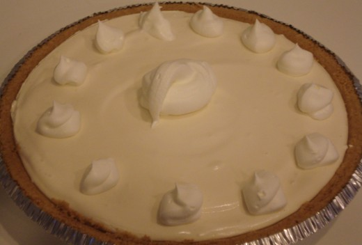 No-bake version of World's Best Key Lime Pie Recipe decorated dotted with whipped cream.