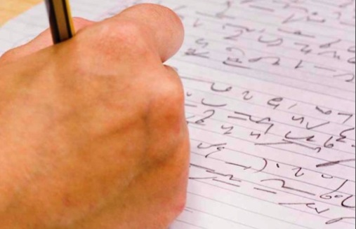 Shorhand: A man practises his shorthand writing