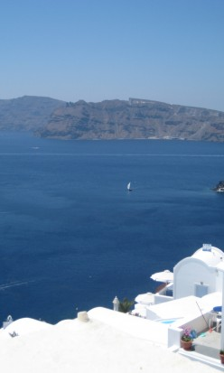photo, A picture of the Caldera water, Santorini island, Greece.  Photo taken from the village of Oia/Ia overlooking the caldera water, to the volcanic island of Nea Kameni.
