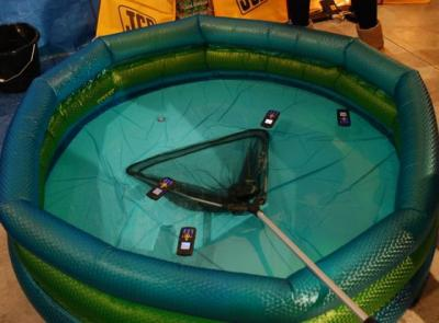 Floating: JCB phones floating in water to prove they are waterproof