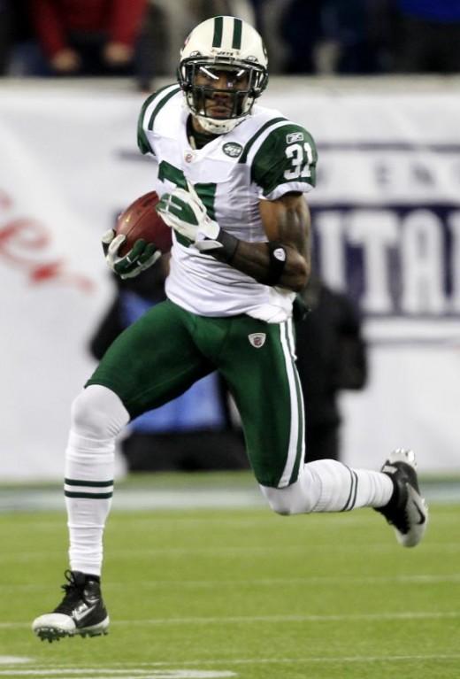 Antonio Cromartie returns a kick (AP Photo/Charles Krupa)