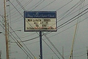 "(Another high quality Blackberry pic).  Random church sign ""New Sermon Series: Just Let It Go Bro"""