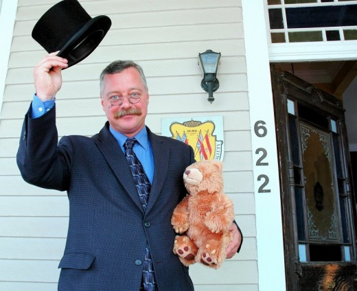 "He's supposed to be ""Teddy"" Roosevelt holding the first Teddy Bear"