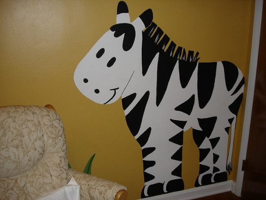 This bright happy zebra is perfect for a baby's room.