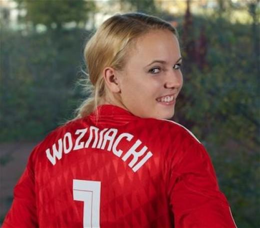 'Wozniacki' at the back for Caroline Wozniacki who looks stylish in the new liverpool home shirt