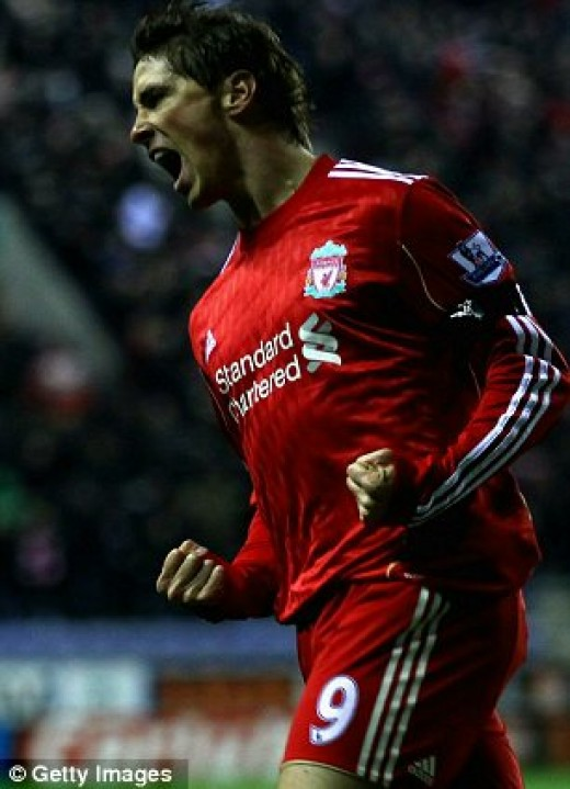 Fernando Torres scores in the new liverpool kit