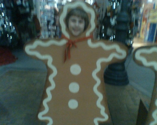 Little Gingerbread Girl having fun while she waited to visit with Santa Clause.