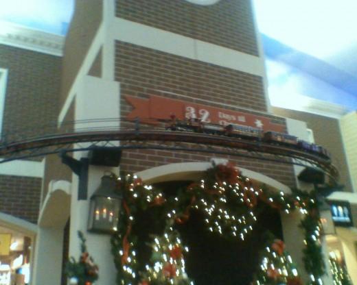 Overhead train tracks run above Santa's chair and through several shops.