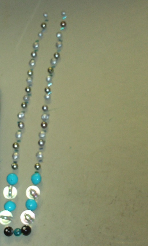 Assemble the pattern you would like to make for your necklace.  You can also use a bead board to do this.
