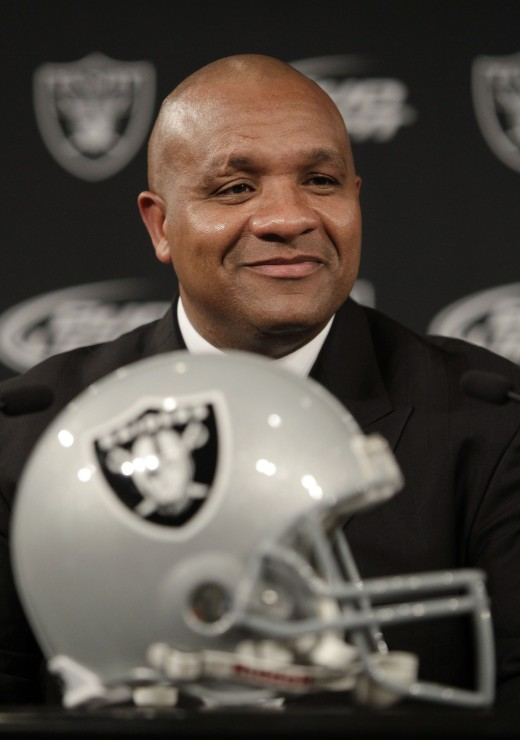 New Oakland Raiders head coach Hue Jackson smiles at a news conference at Raiders headquarters in Alameda, Calif.