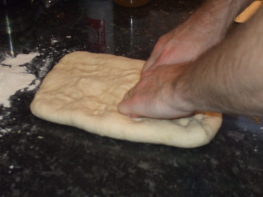 Flatten again, expelling the air from the dough