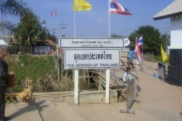 Baan Lem integration point. The yellow King's flag and red, white, blue Thai flag tells me I am still in Thailand. I left my passport at the Thai immigration window and carried the photo and copy of passport with me when I crossed over to Cambodia.