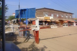 This is looking into the Cambodian town. The Cambodian guard motioned me to go thru a little metal gate and into a gated area that had a duty free shop. I didn't go into the shop...all I saw was alcohol bottles, cigarette cartons, medications, etc.