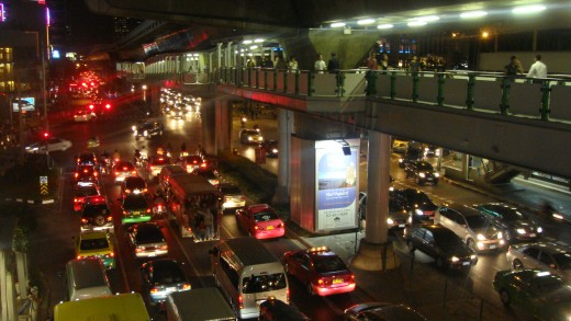 Looking down on Sukumvit street traffic from the BTS Skytrain.
