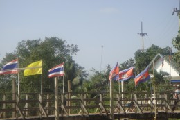 The Thai flags stopped and Cambodian flags began over the water and the bridge