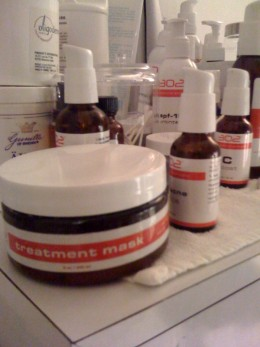 An array of different professional grade 302 products in an aesthetician's treatment room.