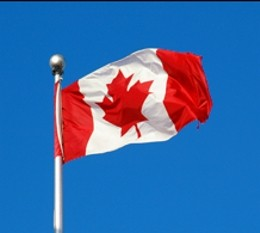 The Canadian flag flapping proudly in the wind.