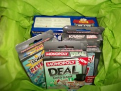 With coupons, these gift tubs of games, popcorn, and a popcorn tub, which you can't see due to tissue paper, cost less than $2.