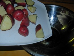 Step 5 - Add quartered Potatoes to bowl