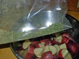 Step 7 - Add coated potatoes to gallon-size plastic bag