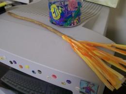 A homemade Firebolt still sits atop Mom's computer
