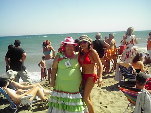 "Me and Spanish lady with traditional ""fair dress"" at the beach."