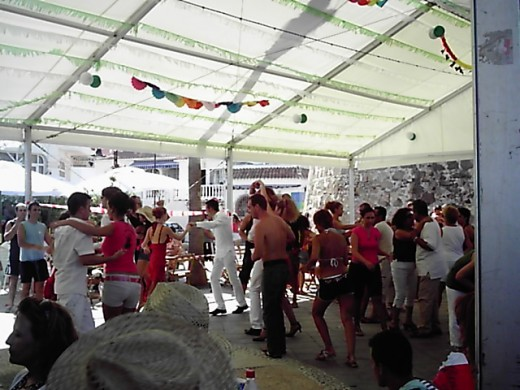 people dancing during the day fair at La Cala