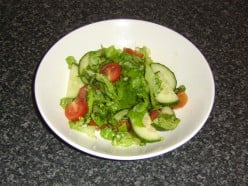 Enjoying such as a simple salad as a snack prior to visitng a restuarant can help to cut costs and be good for your health