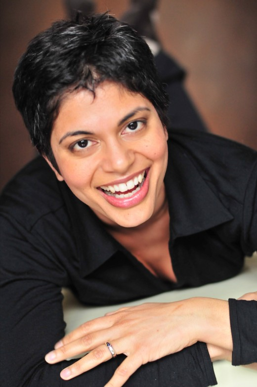 Vancouver based Farah Nazarali, The Smiling Yogi, spreads laughter and light teaching yoga, demonstrating raw food cuisine, and broadcasting a weekly radio show Drishti Point.