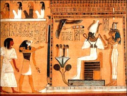Osiris (Right) having offerings being brought to him. A common scene in many Pharaoh's tombs