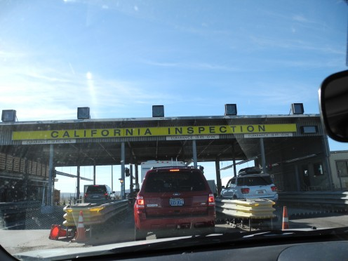 Agriculture Checkpoint going in from Nevada to CA.  (Notice the chemtrail laced skies above the building structure).