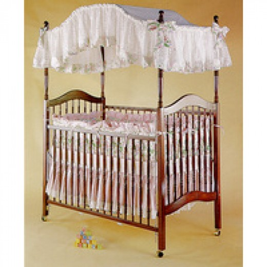 This gorgeous canopy crib is a product of Angel Line furniture. This canopy sells for $500.00 or less.