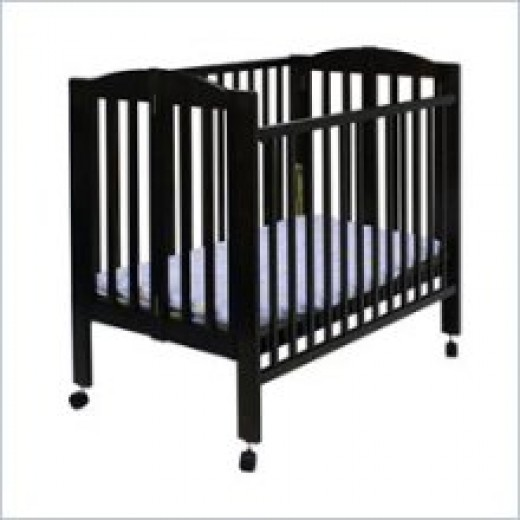 Featured is a Dream on Me portable AND convertible crib, priced at under $100.00