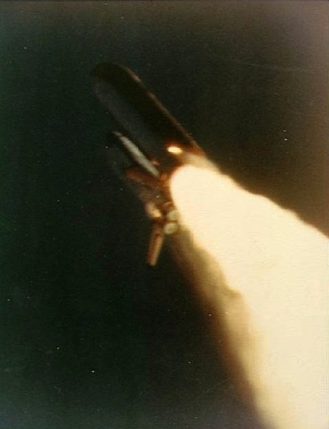 approx 58.32 seconds aft launch photo shows an unusual plume in the lower part of right hand solid rocket booster (SRB)